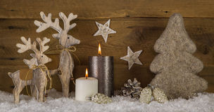 Natural wooden white brown christmas decoration with two burning Stock Photos
