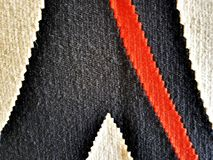 Texture of a wool carpet. Natural wool carpet with handmade patterns. Texture stock photos