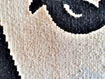 Texture of a wool carpet. Natural wool carpet with handmade patterns. Texture royalty free stock photography