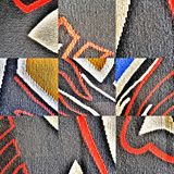 Texture of a wool carpet. Natural wool carpet with handmade patterns. Texture royalty free stock images