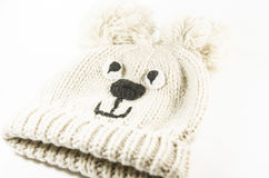 Natural woolen warm baby hat for winter. Funny and beautiful Stock Photo