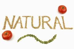 Natural written with wheat kernels Royalty Free Stock Photo
