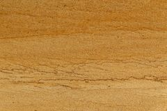Natural yellow rough sand stone texture close up background