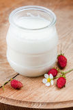 Natural yoghurt in a glass pot Royalty Free Stock Image