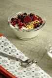 Natural yogurt with berries. On a wooden table for a sweet snack Royalty Free Stock Photos