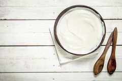 Natural yogurt in a bowl. Stock Photo