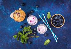 Natural yogurt with fresh blueberries and a muffin. Stock Photo