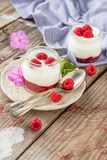 Natural yogurt with fresh raspberries and. Raspberry jam for breakfast in portion jars on a wooden background. selective Focus Stock Photo