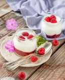 Natural yogurt with fresh raspberries and. Raspberry jam for breakfast in portion jars on a wooden background. selective Focus Stock Photos
