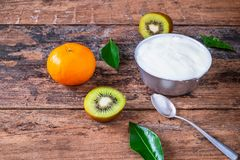 Natural yogurt and fruit on wooden table. royalty free stock photo
