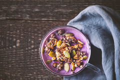 Natural yogurt and granola in a glass cup Royalty Free Stock Image