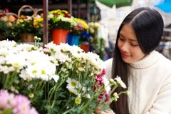 Natural young asian woman smiling with white flowers Stock Photo