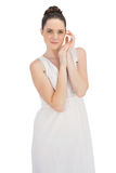 Natural young model in white dress posing Royalty Free Stock Photo