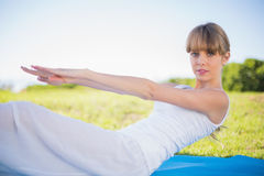 Natural young woman exercising outside Royalty Free Stock Photos