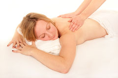 Natural young woman receiving a massage Stock Images