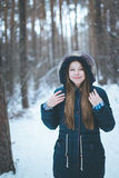 Natural young woman in winter forest Royalty Free Stock Photography