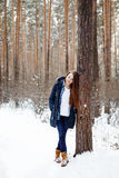 Natural young woman in winter forest Stock Image