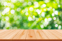 Naturaleza abstracta borrosa con el bokeh y el piso de madera Fotografía de archivo