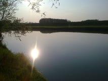 Naturaleza agua, río, costa, puesta del sol, kolubara Fotos de archivo libres de regalías
