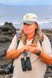 Naturalist guide showing shed shell of Sally lightfoot crab. (Grapsus grapsus) on Chinese Hat island, Galapagos National Park, Ecuador Stock Image