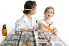 Naturalist little girls with butterfly collection. Naturalist little girls playing with big pencil and butterfly collection Royalty Free Stock Images