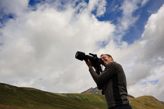 Naturalist photographer. With zoom lens Stock Images