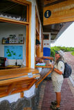 Naturalist shaking hands with the ranger at Charles Darwin Resea. Rch Station on Santa Cruz Island, Ecuador. Research Station is used to conduct scientific Stock Photography