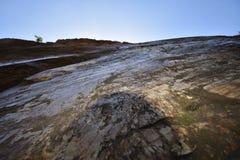 Naturally polished slickenside rock at Corona Heights Park, San Francisco, 4. stock photo