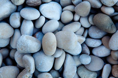 Naturally polished white rock pebbles background Royalty Free Stock Photos