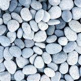 Naturally polished white rock pebbles background Royalty Free Stock Photography