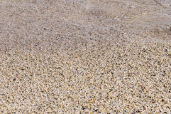 Naturally rounded gravel at sea shore, nature sea background tex Royalty Free Stock Photos