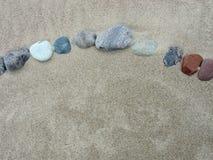 Naturalni kamienie na piasku Obrazy Stock