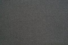 Naturalny czarny tło syntetyczna tkanina Zdjęcia Royalty Free