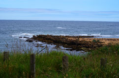 Naturalny Rockowy molo na kanale Obrazy Royalty Free