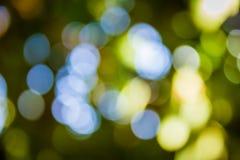Naturalny zielony Bokeh tło, Abstrakcjonistyczni tła Obrazy Stock