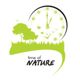 Nature. Trees and grass with big clock Stock Photo