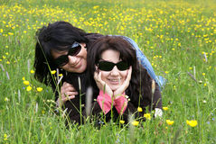 Among the nature. Two young women among the nature Stock Images