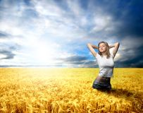 Nature. A beautiful girl in a corn-field Stock Photography