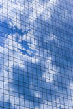 Nature and architecture. Reflection of clouds in modern building Stock Photos
