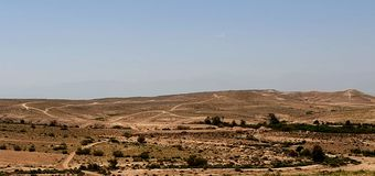 Nature of areas. The nature of the areas is semi-desert, with small oases, plateaus, foothills and water ways And roads like a race track stock image