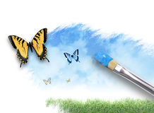 Nature Artist Painting Cloud Sky with Butterfly. An artist paintbrush is painting a spring, summer nature scene on a white isolated background. There are Stock Image