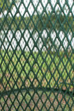 Nature as seen through a metal waste bin Royalty Free Stock Photography