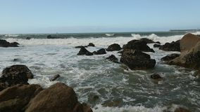 Nature. Atlantic ocean surf, splash over the stones. stock video footage
