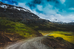 Nature background beautiful landscape mountains road hills clouds Iceland Royalty Free Stock Photos