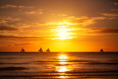 Nature background, beautiful sunset on sea with sailboat Stock Photos
