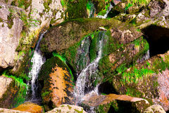 Nature background with big stones and waterfall Stock Photo