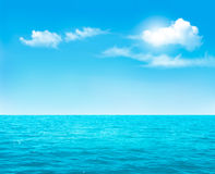 Nature background - blue ocean and blue cloudy sky. Royalty Free Stock Photos