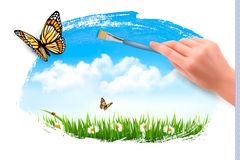 Nature background with butterflies and hand with brush. Royalty Free Stock Image