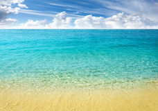 Nature background, clear water and blue cloudy sky. Royalty Free Stock Image