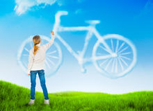 Nature background with a girl drawing bicycle Stock Photography